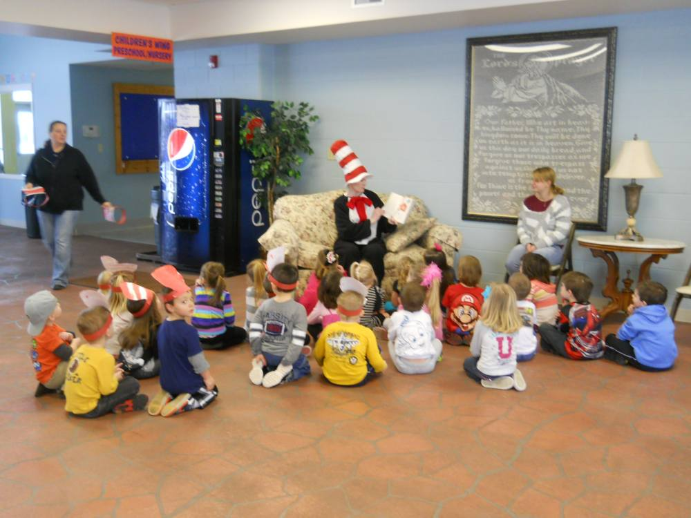 Cat in the Hat reading to the children